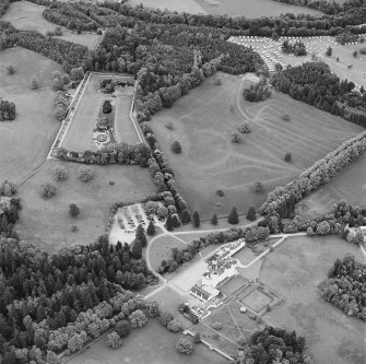 Oblique aerial view of Blair Castle centred on the country house, garden and walled garden, taken from the W.
