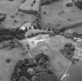 Oblique aerial view of Blair Castle centred on the country house and garden, taken from the WSW.