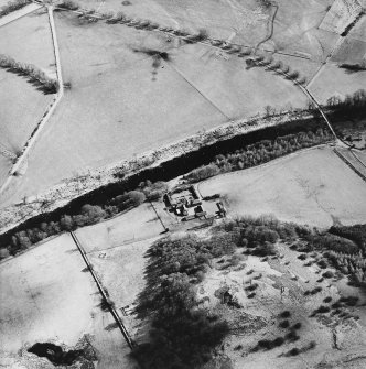 Oblique aerial view centred on the farmstead, taken from the WNW.