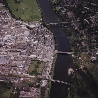 Perth town centre, oblique aerial view, taken from the S, centred on three bridges over the River Tay.