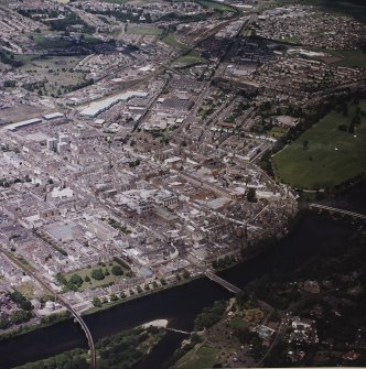 Perth town centre, oblique aerial view, taken from the SE, centred on the town centre and three bridges over the River Tay.