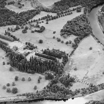 Oblique aerial view of Murthly Castle centred on the castle, chapel and walled garden, taken from the NE.
