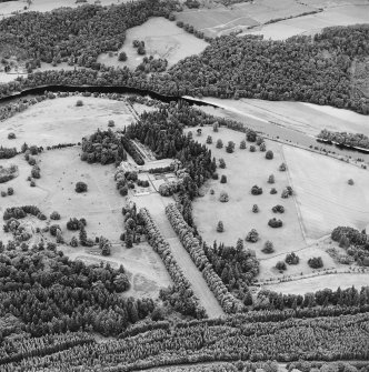 Oblique aerial view of Murthly Castle centred on the castle, chapel and walled garden, taken from the S.