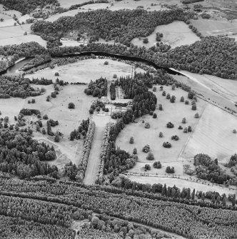 Oblique aerial view of Murthly Castle centred on the castle, chapel and walled garden, taken from the SSE.