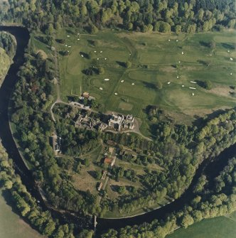 Oblique aerial view centred on the country house with golf club house and remains of military camp adjacent, taken from the NW.