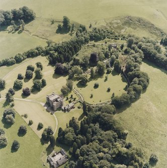 Oblique aerial view centred on the country house and tower-house, taken from the N.