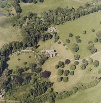 Oblique aerial view centred on the country house and tower-house, taken from the S.