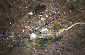 Oblique aerial view centred on the reconstructed horizontal mill and corn drying kiln, taken from the WNW.