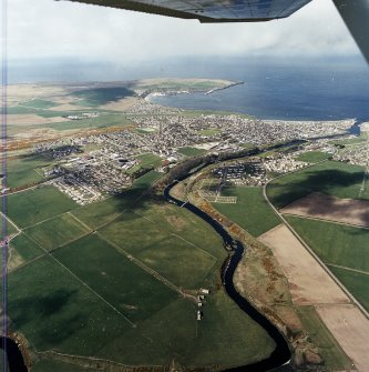 General oblique aerial view looking across Thurso towards Scrabster and Holborn Head, taken from the SSW.