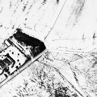 Oblique aerial view under snow, from ENE.