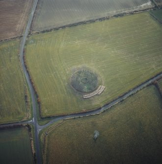 Oblique aerial view centred on the remains of the recumbent stone circle, taken from the N.