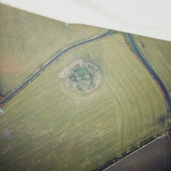 Oblique aerial view centred on the remains of the recumbent stone circle, taken from the SSW.