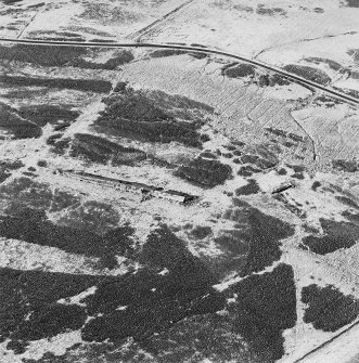 Oblique aerial view of Sheriff Muir centred on the remains of the Atlantic Wall, depot and tramway, taken from the ESE.
