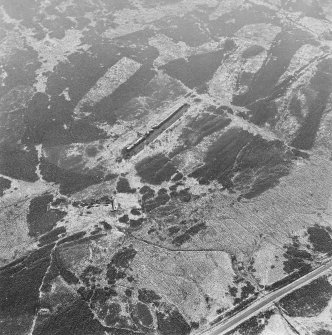 Oblique aerial view of Sheriff Muir centred on the remains of the Atlantic Wall, depot and tramway, taken from the NNW.