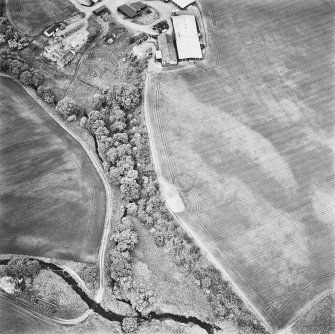 Leadketty, oblique aerial view, taken from the ESE, centred on the cropmarks of an enclosure and parts of a pit-defined enclosure.
