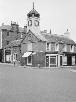 View of the former Town House, High Street, Moffat, from south west, showing the premises of Wallace Bros. Butchers and the Moffat Toffee Shop.