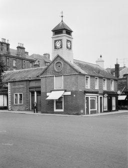 View of the former Town House, High Street, Moffat, from south west, showing the premises of Wallace Bros. Butchers.