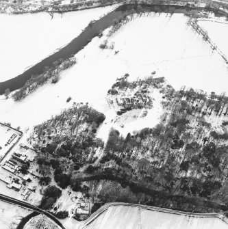 Oblique aerial view centred on the remains of the country house, taken from the NNW.