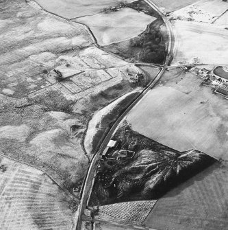 Haywood, Droveloan and Greenbank, oblique aerial view, taken from the E, showing Haywood village with the remains of miners' rows and a farmstead in the centre of the photograph, a cottage and the two bings of a coal mine adjacent to the dismantled railway in the bottom centre, and areas of rig beside Droveloan cottage in the bottom left-hand corner, and Greenbank in the top left-hand corner.