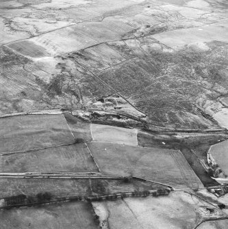 Haywood Colliery, Tashieburn and Greenbank, oblique aerial view, taken from the N, showing Haywood coal mine with adjoining railway in the centre of the photograph, Tashieburn coal mines in the bottom right-hand corner, and an area of rig at Greenbank in the top half.