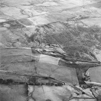 Haywood Colliery, Tashieburn and Greenbank, oblique aerial view, taken from the NNE, showing Haywood coal mine with adjoining railway in the centre of the photograph, Tashieburn coal mines in the bottom right-hand corner, and an area of rig at Greenbank in the top half.