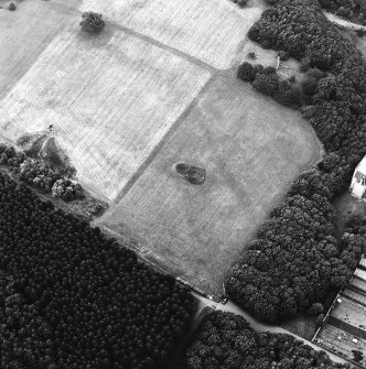 Oblique aerial view of Bo'ness, Kinneil, centred on the cropmarks of the Antonine Wall with a church adjacent, taken from the SE.