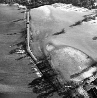 Castle Craig, oblique aerial view, taken from the NW, showing the traces of an old road running up the centre of the photograph.