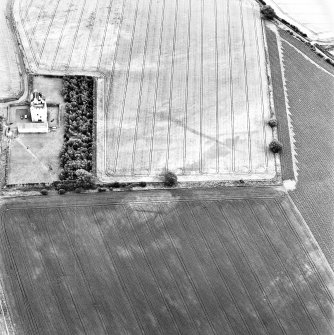 West Mains, oblique aerial view, taken from the NW, centred on linear cropmarks. Falside Castle is visible in the centre left of the photograph.