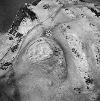 Oblique aerial view centred on the remains of the fort and settlement, taken from the E.