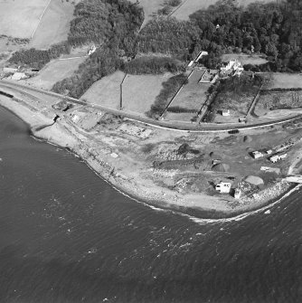 Aerial view of the lighthouse, the church and burial ground, Lochryan House, Glen Cottage military camp, Cairnryan military head quarters and Cairnryan military railway. View taken from the W.