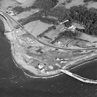 Aerial view of the lighthouse, the church and burial ground, Lochryan House, Glen Cottage military camp, Cairnryan military head quarters and Cairnryan military railway and ship yard. View taken from the SW.