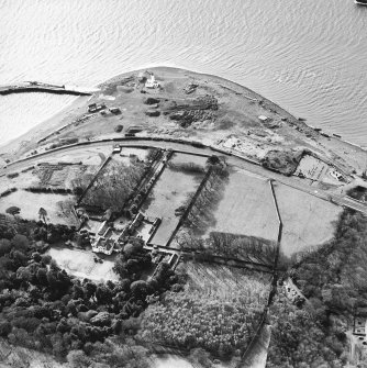 Aerial view of Lochryan House, the military headquarters, the light house, the military railway and ship yard, and the church and burial ground. View taken from the NE.