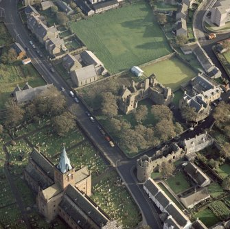 Oblique aerial view of St Magnus Cathedral, Earl's Palace and Bishop's Palace, Kirkwall.