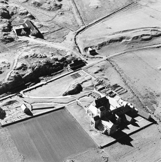 Oblique aerial view of Iona Abbey, taken from the south east, centred on the abbey and the MacLeod Centre.