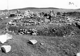 Kebister excavation archive 35 negatives of the settlement (Area V & VI) and the teind barn (Area I):   2-5: Area VI - context 920 and stone feature 908. 6-17: Area I - general and detail views of contexts 178, 1231 & 1232. 18-21: Area VI - contexts 911, 923 & 925. 22-23: Area V - shell midden (1233). 24-25: Area VI - contexts 925 & 927. 26-33: Area I - general and detail views of contexts 180, 181 & 182. 34-37: Area V - shell midden (1233) during excavation, and context 1234 after removal of shell midden.