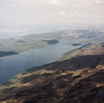 General oblique aerial view looking across Loch Sween towards Tayvallich with the Island of Scarba and the W coast of Argyll beyond, taken from the SE.