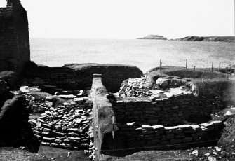 Excavation Photograph: Excavation of broch mound showing courtyard wall, aisled round house and wheelhouse.