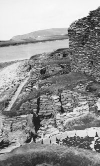 General view of settlement showing broch, wheel houses and Laird's House.