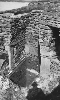 Excavation Photograph: Broch trench showing broch and wheelhouse floors overlying windblown sand.