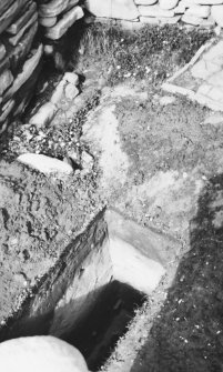 Excavation photograph: Broch courtyard trench; windblown sand overlying Bronze Age midden.