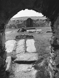 Excavation of cross-base, Kilnave Church, Kilnave. View from East looking from inside the Church through West door to the excavation of the cross base beyond.