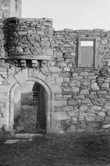 Detail of doorway with protruding turret base above, Mains Castle, Caird Park, Dundee.