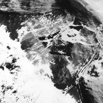 Woden Law, fort and associated monuments: air photograph under snow. Professor D. Harding, 1983.