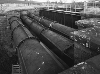 View from S, note the strengthening flanges on the pipe sections.