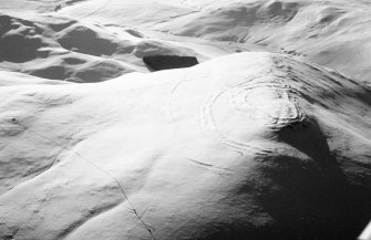Woden Law, fort and associated monuments: air photograph under snow. J Dent, 1991.
