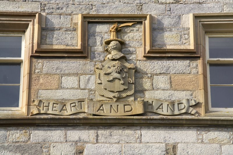 Detail of coat of arms above E entrance