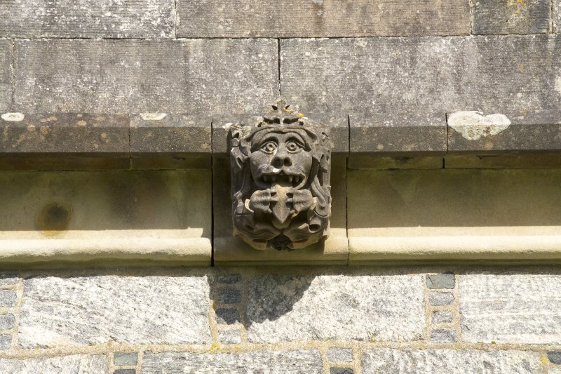 Detail of carved head on SW face