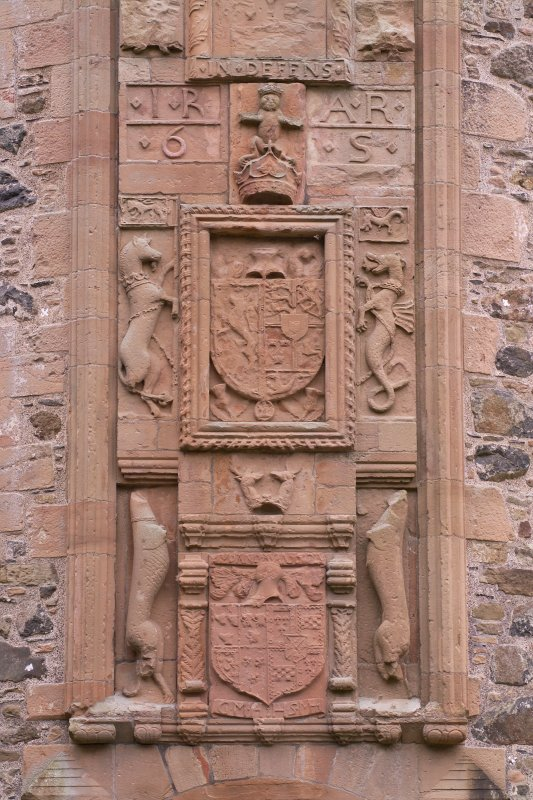 NE Entrance. Carved Heraldic Panels. Detail.
