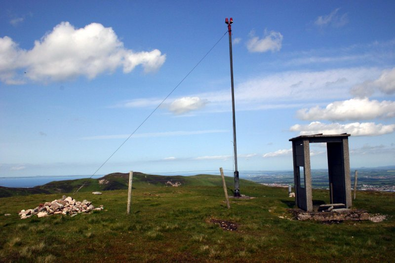 View of marker cairn, beacon and sentry box on summit of Castlelaw Hill, taken from SW