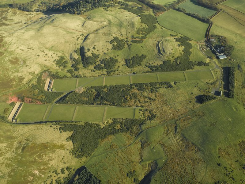 Oblique aerial photograph centered on the rifle ranges at Castlelaw, taken from the W.